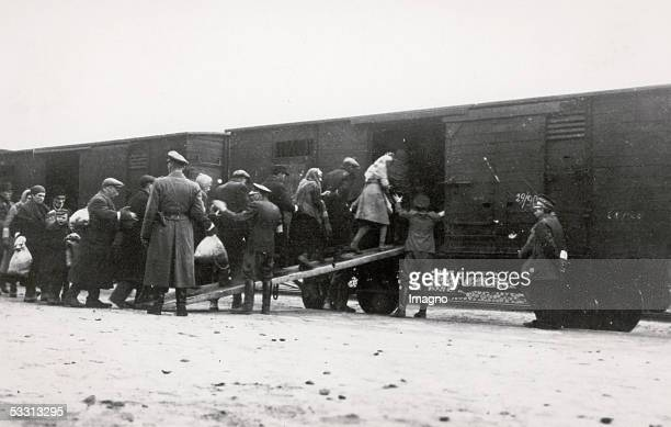 "Holocaust: Deportation of Polish Jews in cattle carriages on ""reloading point"" in Warsaw. On the platform German soldiers. Photography. 1944...."