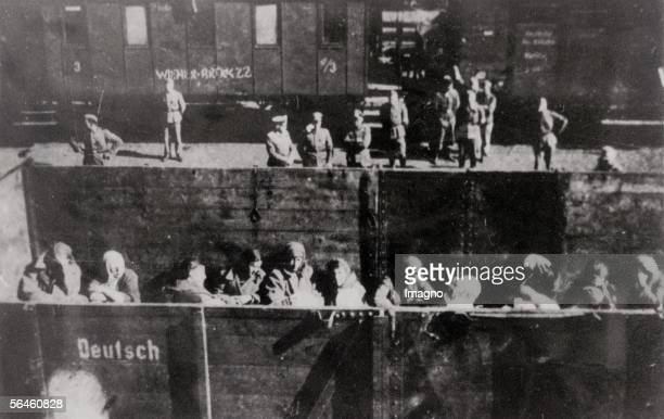 Holocaust Deportation of Polish Jews in open cattle carriages at the reloading point in Warsaw on the platform German soldiers Poland Photography...