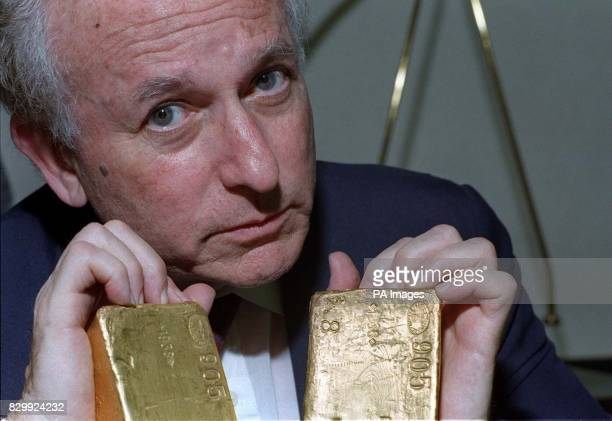 Holocaust Educational Trust chairman and former Labour MP Greville Janner QC with the Nazi gold bars which could contain gold stolen from the bodies...