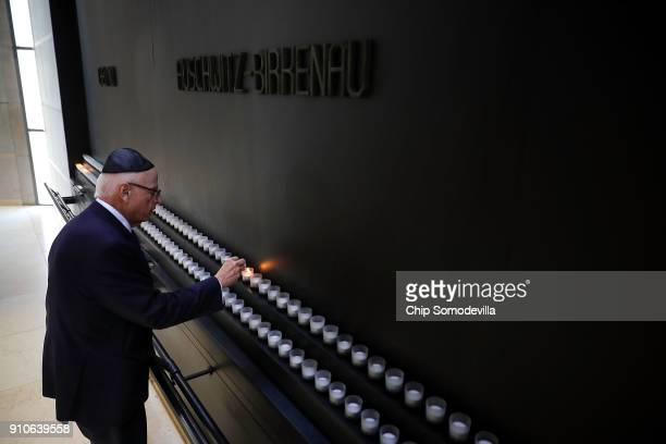 S Holocaust Memorial Council Chairman Howard Lorber lights a candle to commemorate International Holocaust Remembrance Day during a ceremony at the...