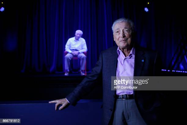 Holocaust survivor Aaron Elster speaks to reporters as he is displayed on a threedimensional hologram at the Take A Stand Center at the Illinois...