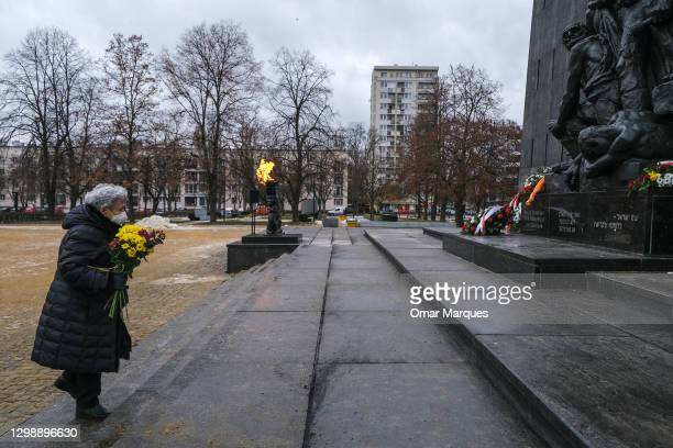 Holocaust survivor and member of the Children of the Holocaust Association, Krystyna Budnicka lays a wreath of flowers by the Monument to the Ghetto...