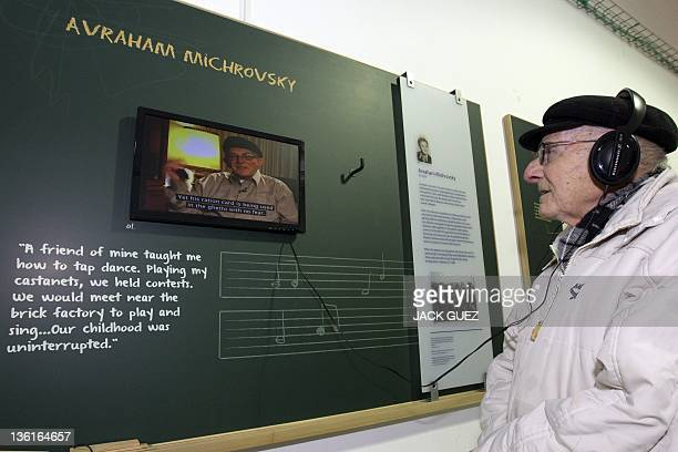 Holocaust survivor Avraham Michorovsky 78yearsold listns to an audio tape of his life story on Decemeber 28 2011 in Tel Aviv during a an exhibition...