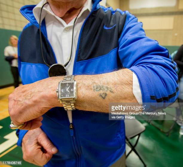 Holocaust survivor Ben Stern shows his concentration camp tattoo that includes a triangle that identified him to be a dangerous prisonernHomestead...