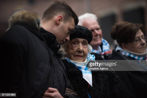 Holocaust survivor chats with a young man under the Death Wall during the 73rd anniversary of the liberation of the former NaziGerman concentration...