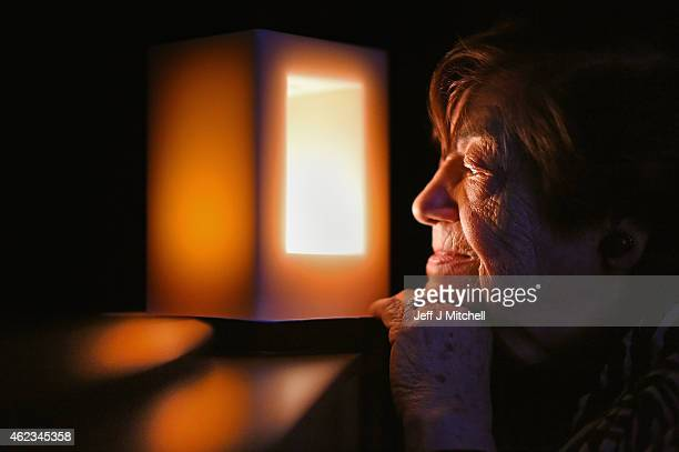 Holocaust survivor Ela Weissberger, aged 84 looks at one of only 70 special candles, and the first in Scotland,commissioned to mark 70 years since...