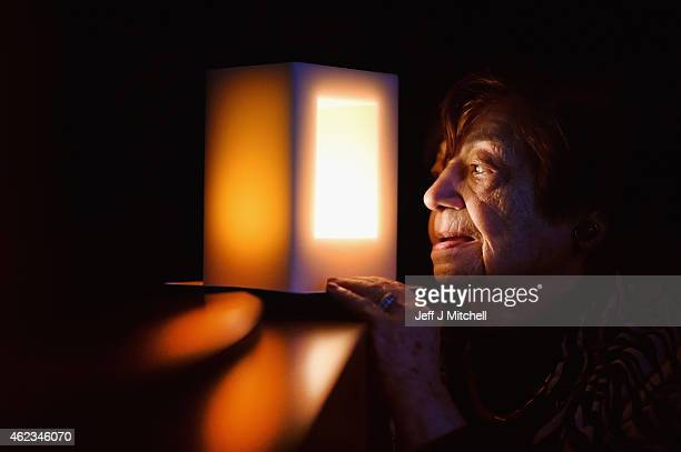 Holocaust survivor Ela Weissberger aged 84 looks at one of only 70 special candles and the first in Scotlandcommissioned to mark 70 years since the...