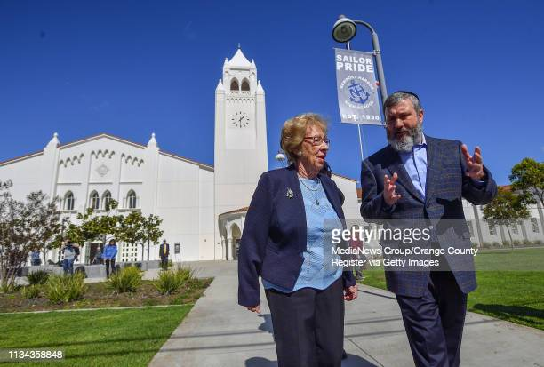 Holocaust survivor Eva Schloss left chats with Chabad Rabbi Reuven Mintz at Newport Harbor High School after Schloss meet with students involved in a...