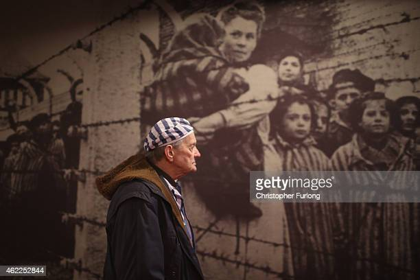 Holocaust survivor Igor Malicky, aged 90, from Cracow, pauses for thought as he tours an exhibition inside the former Auschwitz I concentration camp...