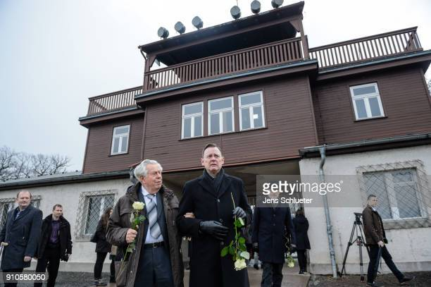 Holocaust survivor Kurt Pappenheim and Thuringia's State Premier Bodo Ramelow hold flowers at the Buchenwald concentration camp memorial to...