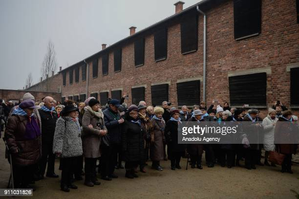 Holocaust survivors gather under the Death Wall during the 73rd anniversary of the liberation of the former NaziGerman concentration and...