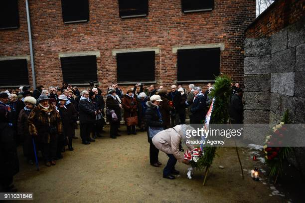 Holocaust survivors lay wreaths and light candles under the Death Wall during the 73rd anniversary of the liberation of the former NaziGerman...