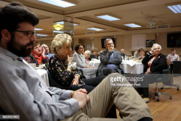 Holocaust survivors their friends and family listen as the survivors share their stories on April 22 2018 during the annual brunch honoring holocaust...