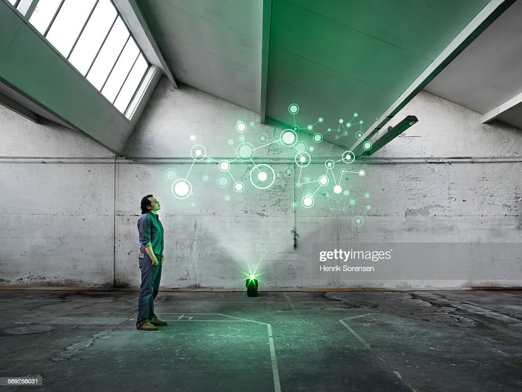 Hologram in warehouse : Stock Photo