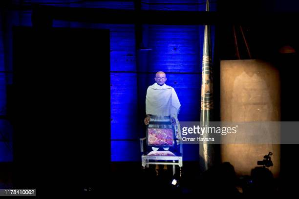 A hologram of Mahatma Gandhi listens to speeches during the Fourth Ahinsa Lecture at the UNESCO Head Office on October 01 2019 in Paris France The...