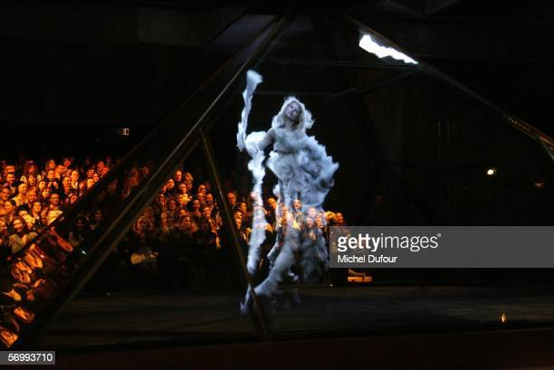 A hologram of model Kate Moss on the catwalk at the Alexander McQueen fashion show at Paris Fashion Week Autumn/Winter 2006/7 on March 3 2006 in...