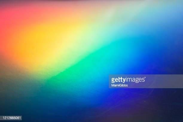 hologram paper reflection sunlight and make gradation - regenbogen stock-fotos und bilder