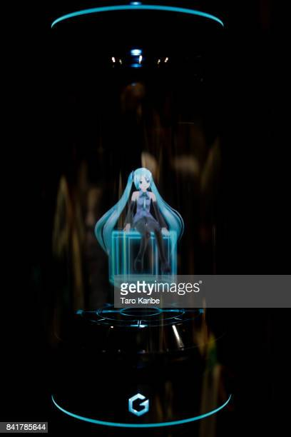 A hologram virtual home robot called 'Living With Hatsune Miku' developed by Gatebox is displayed during the 'Magical Mirai 2017' at Makuhari Messe...
