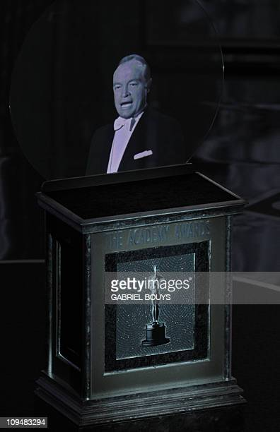 A hologramm of actor Bob Hope appears at a lectern during the announcement of the Visual Effects awards at the 83rd Annual Academy Awards at the...