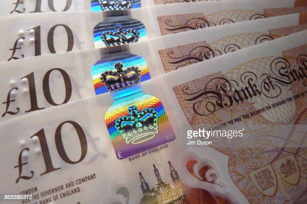 A holographic detail of the new British ten pound note featuring a portrait of Jane Austen on September 27 2017 in London England A polymer £20 note...