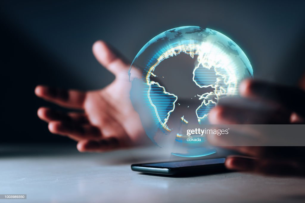 Holographic Earth on smartphone : Stock Photo