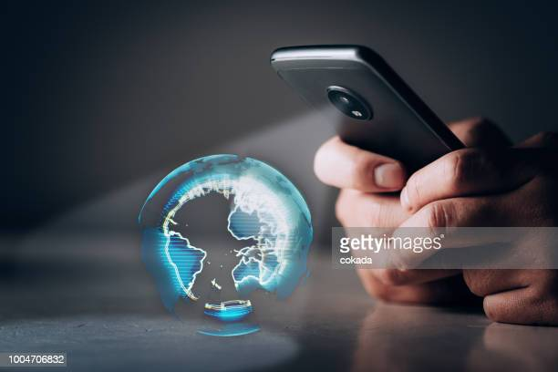holographic earth projection from smartphone - world politics stock pictures, royalty-free photos & images