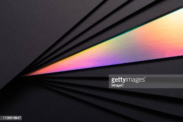 holographic paper in black paper - couches superposées photos et images de collection
