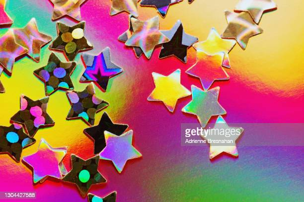 holographic stars on psychedelic background - star shape stock pictures, royalty-free photos & images