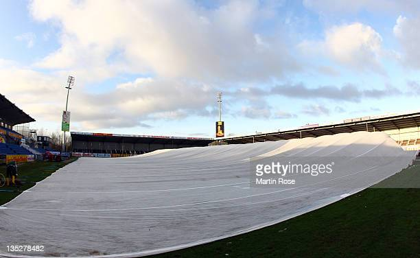 Holstein Kiel protects the pitch against rain and snow with a flex cover to ensure playability at HolsteinStadion on December 8 2011 in Kiel Germany...