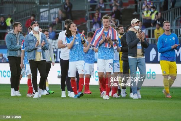 Holstein Kiel's players react after the German second leg play-off relegation Bundesliga football match between second division team Holstein Kiel...