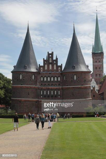 holstentor - the holstein gate, lübeck germany - pejft stock pictures, royalty-free photos & images