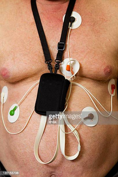 holter monitor on patients chest - holter monitor stock photos and pictures