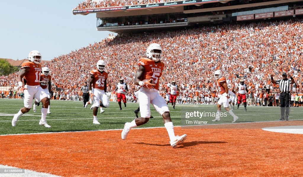 Holton Hill #5 of the Texas Longhorns intercepts a pass and returns it for a touchdown in the first quarter against the Maryland Terrapins at Darrell K Royal-Texas Memorial Stadium on September 2, 2017 in Austin, Texas.