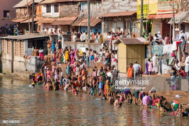 holy bathe, shivaratri, gokarna, karnataka, india - maha shivaratri stock photos and pictures
