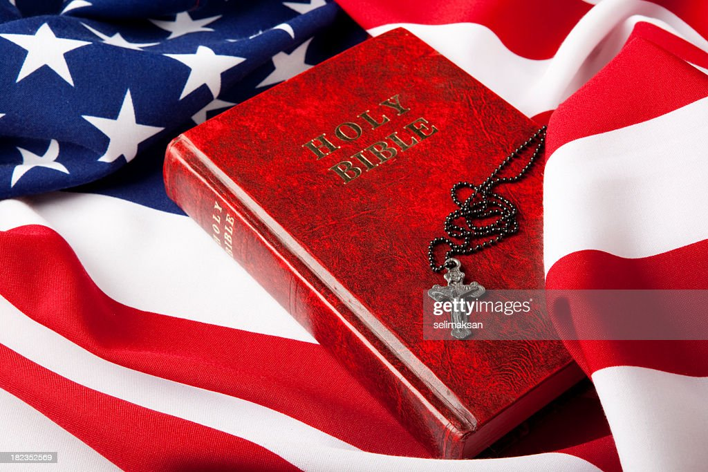 Holy Bible And Cross On American Flag : Stock Photo