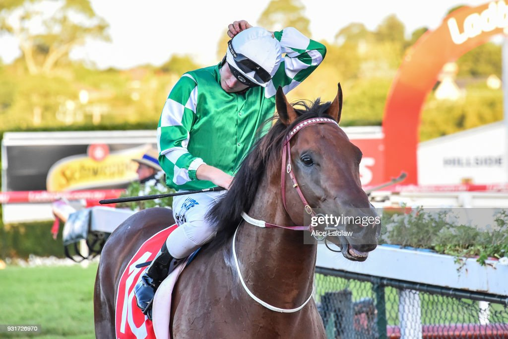 Holy Blade ridden by Ethan Brown returns to scale after winning the Ladbrokes Handicap at Ladbrokes Park Hillside Racecourse on March 14, 2018 in Springvale, Australia.