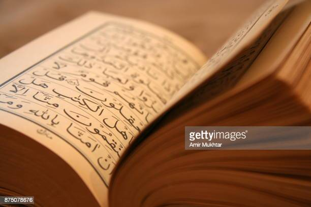 holy book (quran) - holy quran stock pictures, royalty-free photos & images