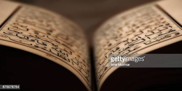 holy book (quran) - arabic script stock pictures, royalty-free photos & images