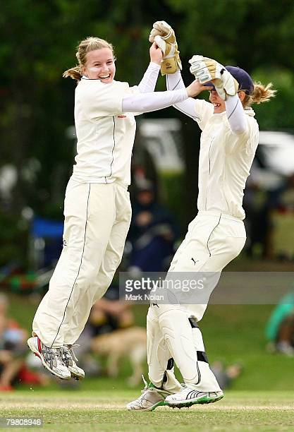 Holy Colvin and Jane Smit of England celebrate the Colvin's caught and bowled dismissal of Shelley Nitschke of Australia during day three of the...