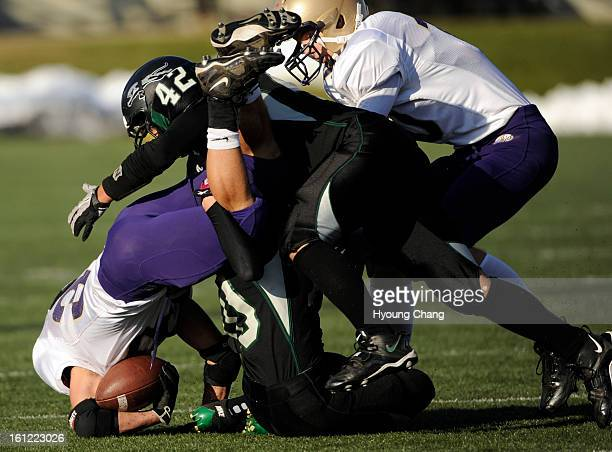 Holy Family RB Connor Clay left is tackled by D'Evelyn LB Mike Doyle in the 1st half of the game at Trailblazer Stadium on Friday Hyoung Chang / The...