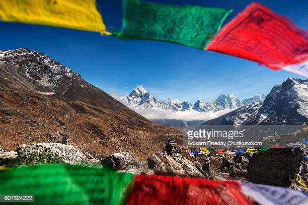 Holy Flagswith view of  Everest mountain peak background.