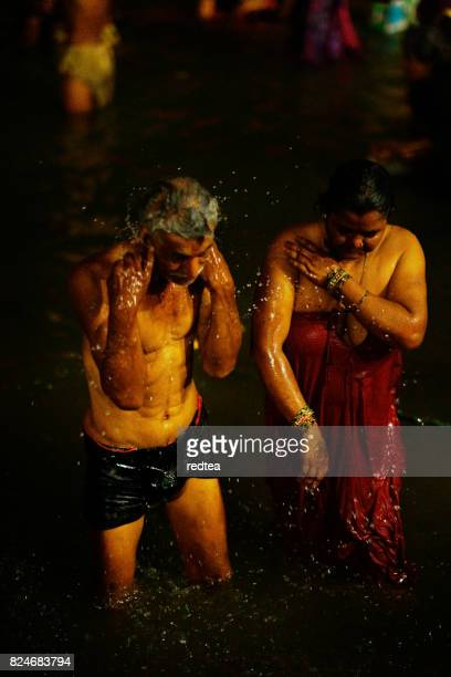holy ghats at haridwar, india - taking a bath stock pictures, royalty-free photos & images