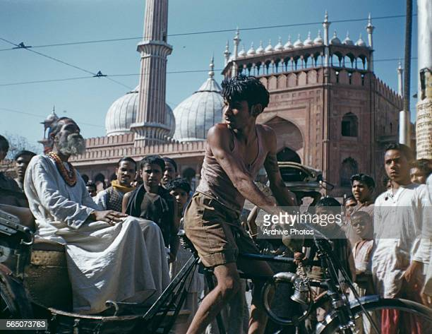 A holy man on a rickshaw outside the Jama Masjid mosque in Delhi India circa 1965