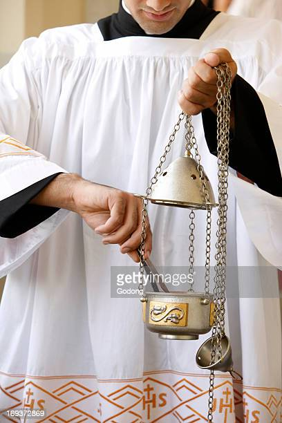 Holy mass in Palestine Altar boy preparing incense