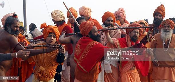 Holy men during a ceremony at banks of the Sangam ahead of Maha Kumbh festival on January 13, 2013 in Allahabad, India. The Kumbh Mela is mass Hindu...