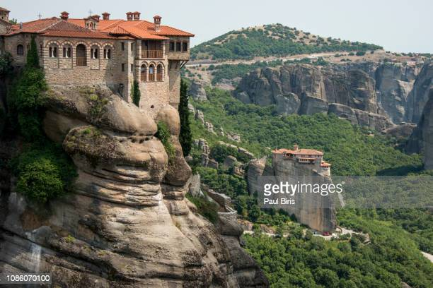 holy monasteries of rousanou and varlaam, monasteries of meteora, greece - meteora stock pictures, royalty-free photos & images