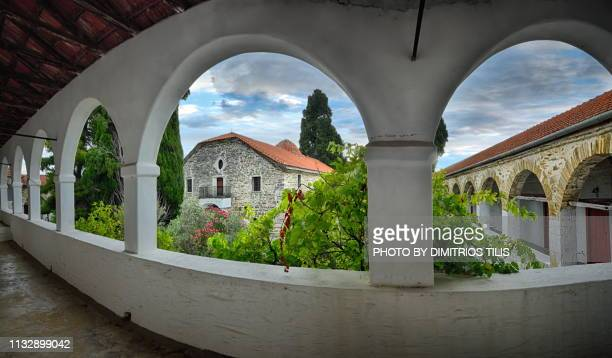 holy monastery of annunciation island (ancient) trikeri panorama - volos stock pictures, royalty-free photos & images