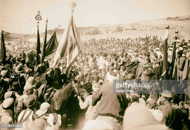 Holy Neby Mousa, Nebi Musa flag receiving the final blessing. 1900, Nabi Musa is the name of a site in the West Bank believed to be the tomb of Moses