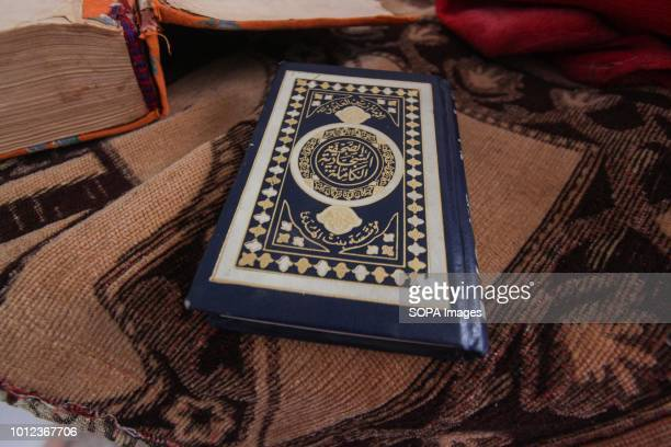 A holy Quran seen in one of the partly destroyed buildings in AlFoah after the government agreed to release 1500 rebel prisoners in return for a...
