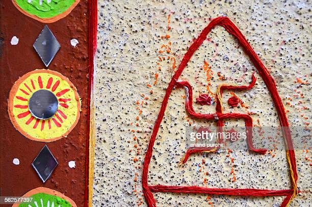 holy swastika made with threads on wall, india - hinduism stock pictures, royalty-free photos & images